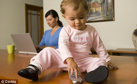 High-tech tots: Babies are shunning more traditional toys in favour of smartphone apps