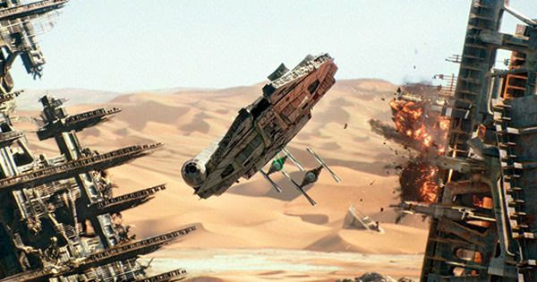 The Millennium Falcon evades First Order TIE Fighters on the planet Jakku in STAR WARS: THE FORCE AWAKENS.