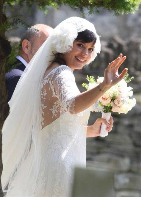 Lily Allen marries Sam Cooper in long lace Delphine