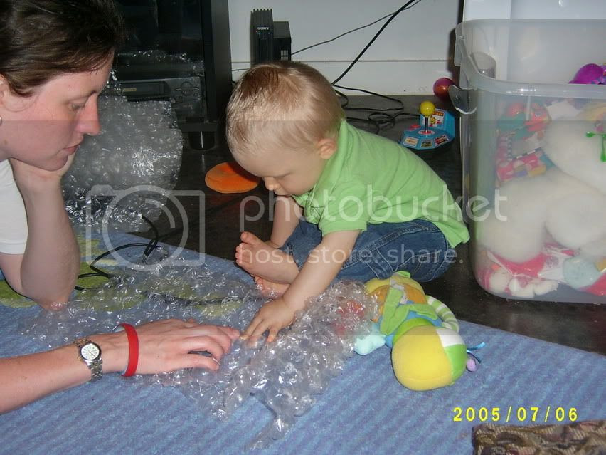 Gabriel and Mommy popping bubble wrap