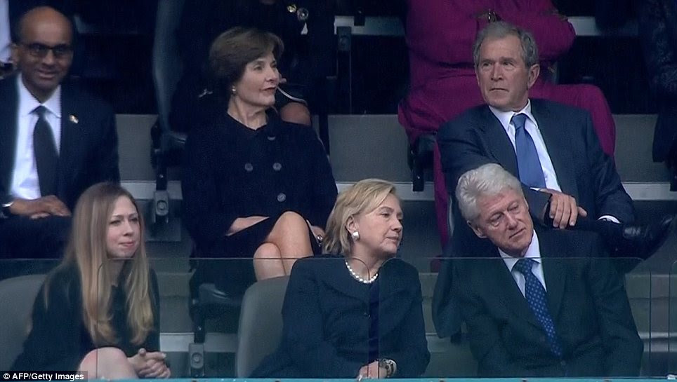 Rivals: But George W. Bush, pictured with wife Laura, apparently got on well with his predecessor Bill Clinton, pictured with wife Hillary and Chelsea