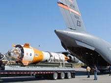 The jumbo dart used as part of the Ares I parachute test is loaded  into the back of a U.S. Air Force C-17