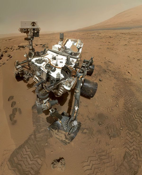 A self-portrait of NASA's Curiosity Mars rover, taken with a camera on her robotic arm on October 31, 2012. Mount Sharp lays in the background.