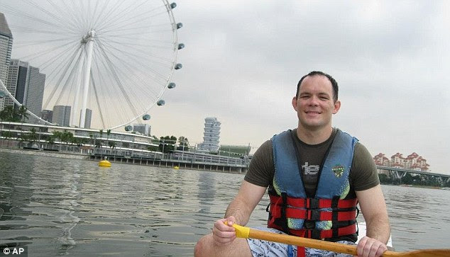 Shane Todd, shown here on a kayak in Singapore, was found hanging from a bathroom door in his apartment in the island nation in June 2012. His mother says he told her months earlier that he felt his life was under threat