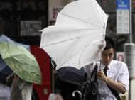 A man walks with his umbrella against strong winds as Typhoon Saola approaches Taiwan in Taipei August 1, 2012. REUTERS/Pichi Chuang