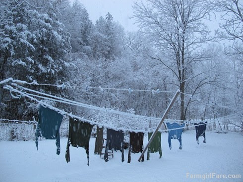 Drying clothes on the line in a snowstorm - FarmgirlFare.com