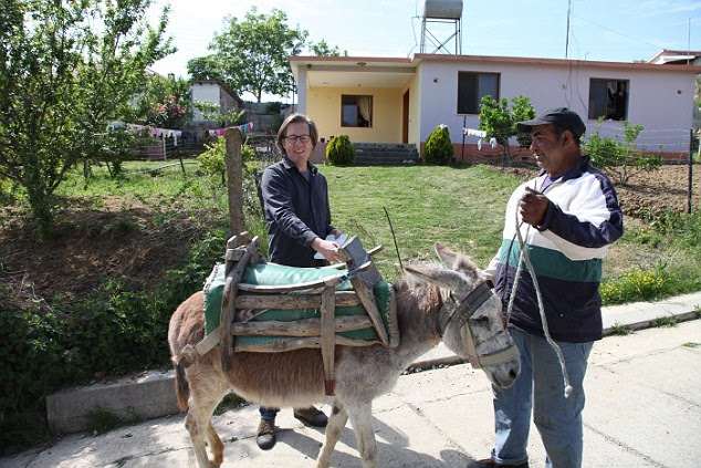 Qemal was sitting in the shade of a peach tree in the village of Gërdec, trying to find a buyer for a dishevelled donkey munching on the kerbside grass nearby