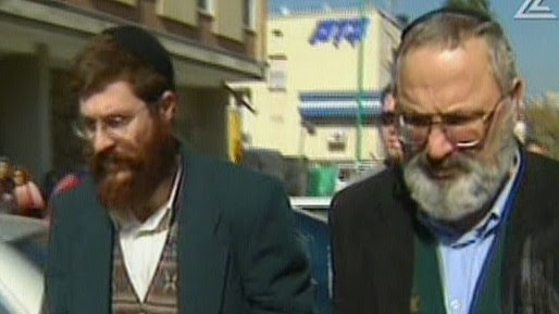 Eli Cohen, right, and Avihai Weinstein are suspected of selling arms to Iran. (screen capture: Channel 2)