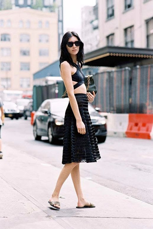 Le Fashion Blog Street Style All Black Look Sunglasses Strappy Open Back Crop Top Midi Skirt Chain Strap Bag Flat Sandals Via Vanessa Jackman