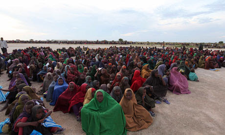 Internally displaced Somalis wait to receive food rations