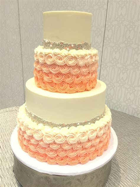 Silver and coral buttercream wedding cake with gorgeous