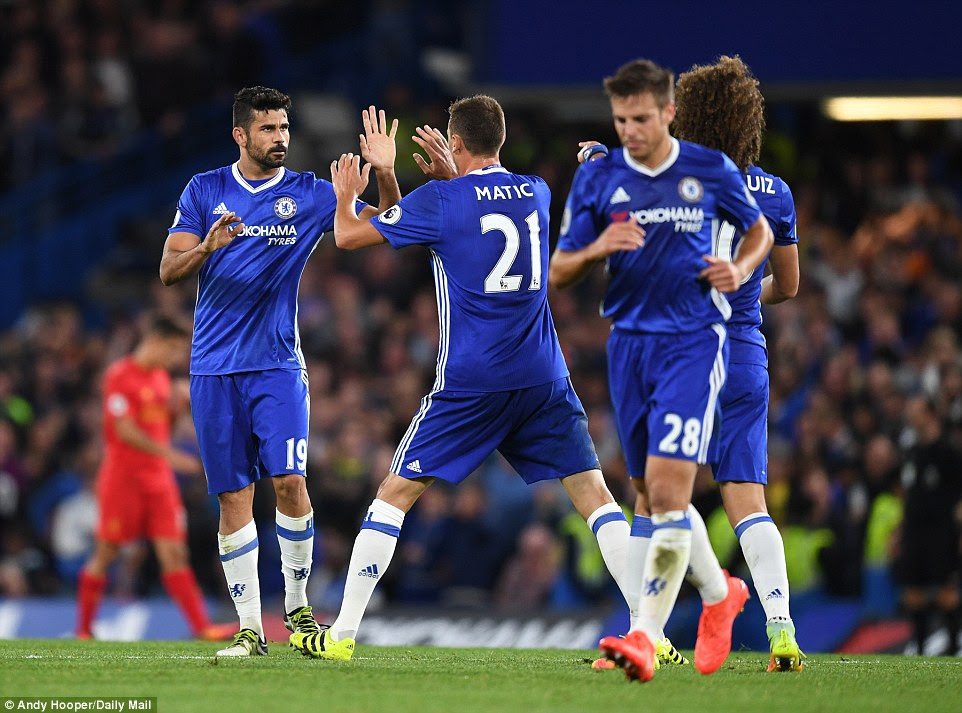 Diego Costa (left) flashes his infamous stare after pulling a goal back for Chelsea in second half of the Premier League tie