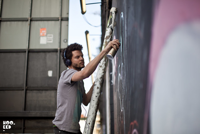 South American street artists Sliks & Bailon work on a mural on Great Eastern Street, London.
