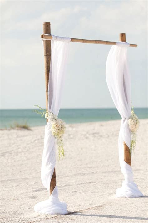 simple bamboo white wedding arch on the beach   Deer Pearl
