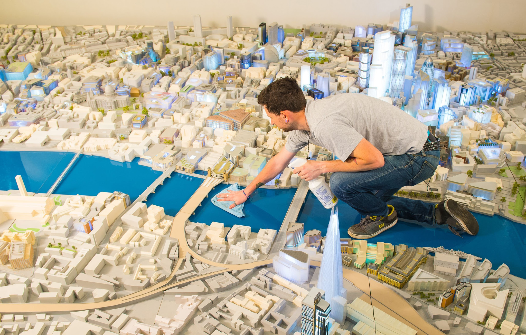 James Massey of Piper's Model Makers cleans the City of London s official 1:500th scale architectural model of central London, which has gone on public display at the City Centre gallery, London.