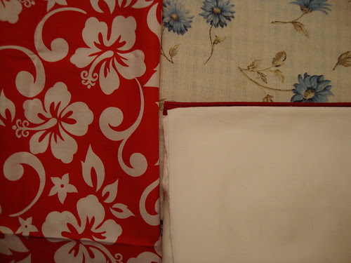 White fabric with brick piping; red and white hibiscus print