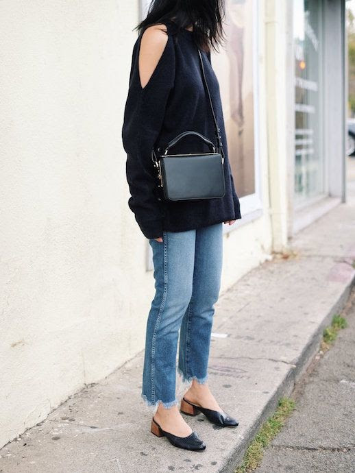 Le Fashion Blog Cold Shoulder Sweater Leather Bag Raw Hem Jeans Textured Mules Via Andy Heart