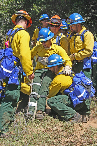 Firefighter trainees practice rescuing an injured firefighter during the Forest Service and California Conservation Corps joint training session.  (U.S. Forest Service photo)