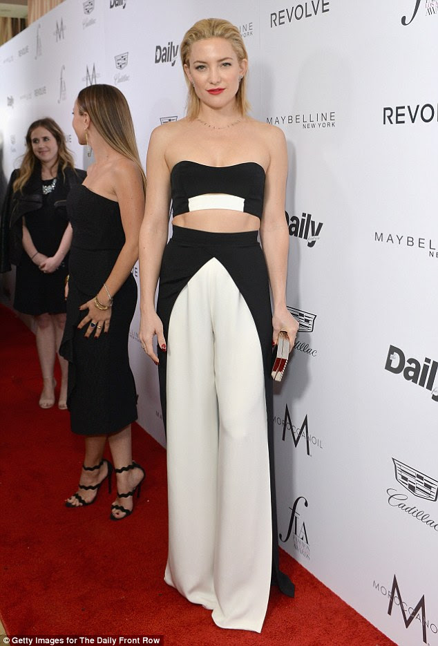 The mother-of-two revealed her toned midriff in the outfit which featured a black and white block design