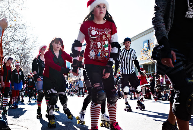a swarm of roller girls skating