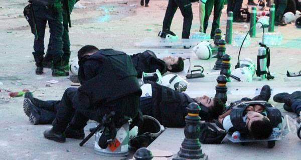 Exhausted police force takes naps on the streets of Harbiye, near Taksim.