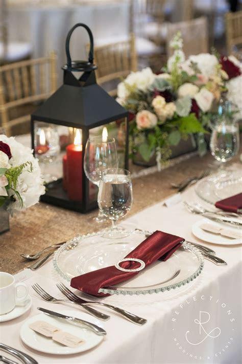 Ivory, blush and burgundy wedding decor with lantern and