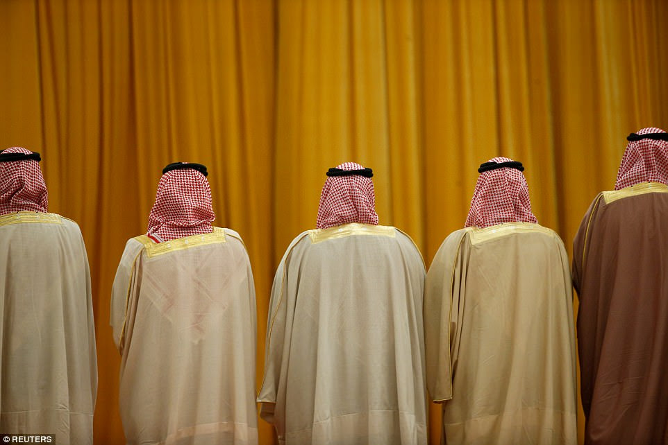 Members of the Saudi delegation wait for the arrival of China's President Xi Jinping and Saudi King Salman bin Abdulaziz Al-Saud before a welcoming ceremony at the Great Hall of the People in Beijing, China, on March 16