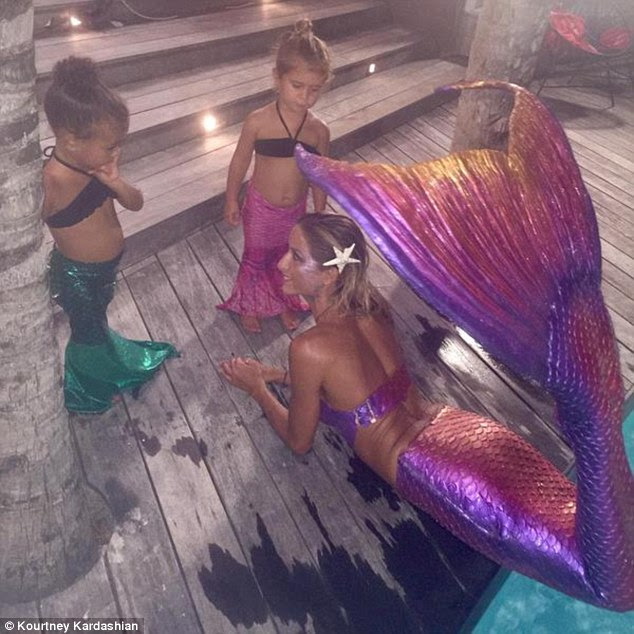 Little mermaids: Kourtney Kardashian shared this picture of North West and Penelope meeting a siren of the sea while on holiday in St Barts