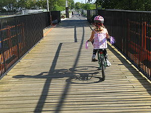 Girl cycling south on new West Toronto RailPat...