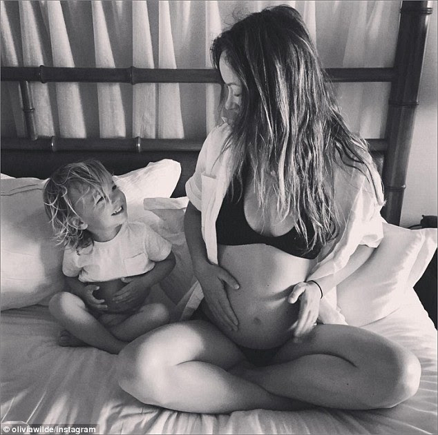 'Matching baby bumps!' Olivia Wilde announces she's pregnant as she shares sweet photo of her and son Otis