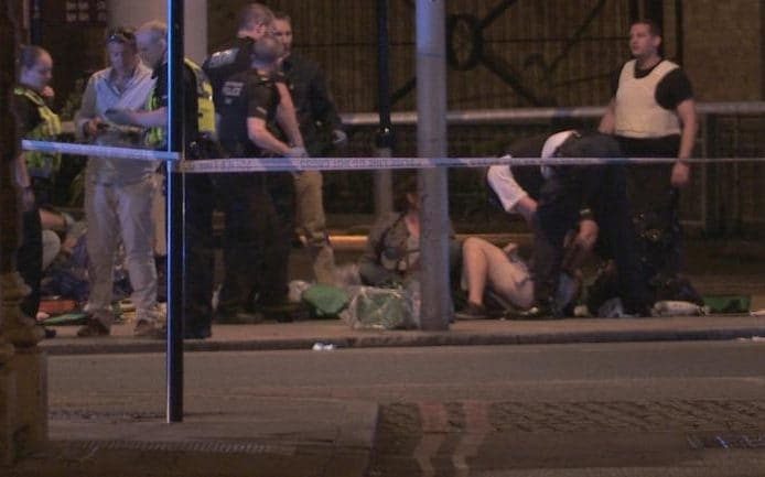 People receive medical attention in Thrale Street near London Bridge following a terrorist incident.