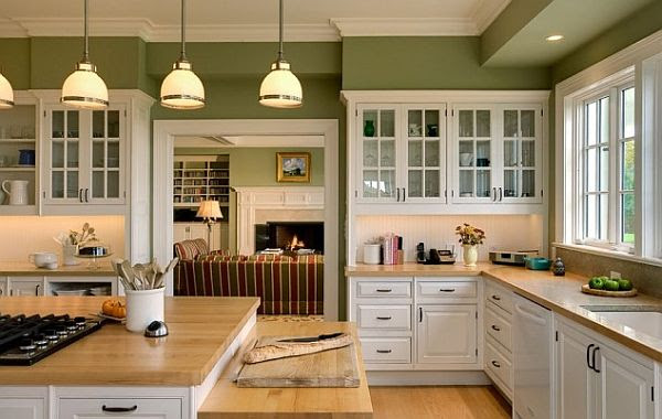 white kitchen cabinetry with wooden furnishings and green ...