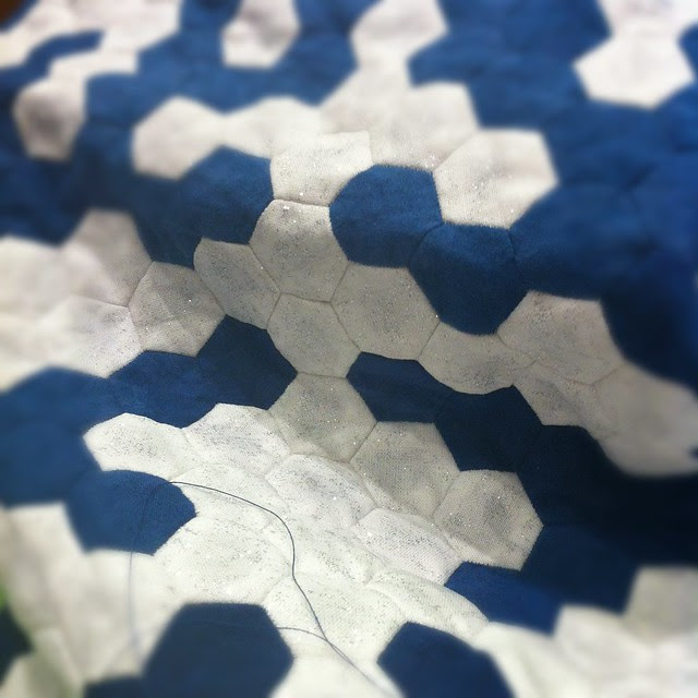 Close up of Cathy's sparkly snowflake quilt
