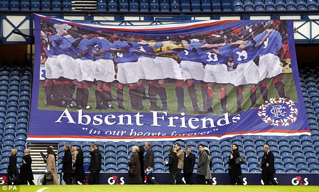 In remembrance: Mourners arrive at a memorial service at Ibrox