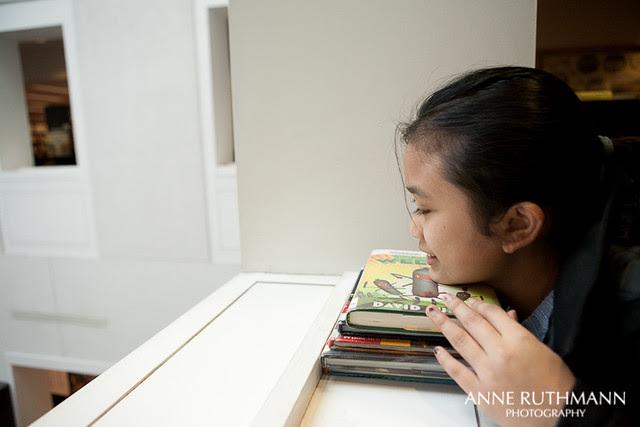 Girl resting head on books