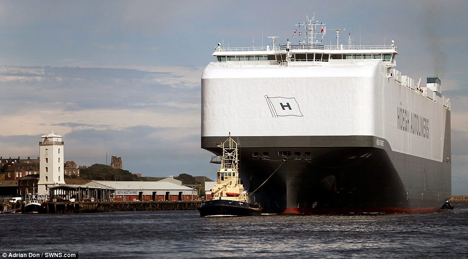 The 14-deck vessel (pictured arriving into Tyne and Wear this week), which is 200 metres in length and 36 metres wide, has a deck space of 71,400 square metres and if all of the 8,500 cars it could carry were stood end to end, they would measure a whopping 26 miles in length