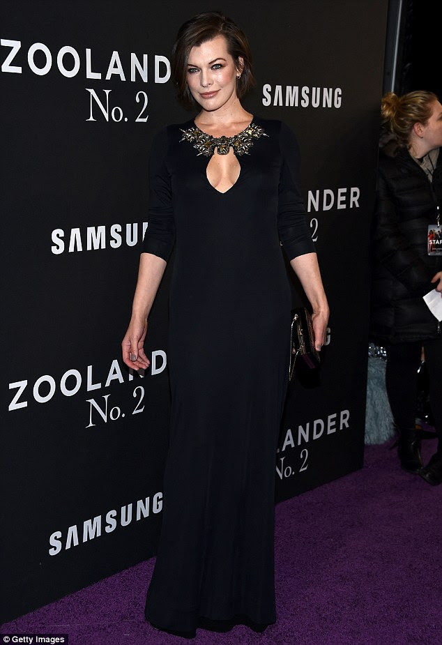 Natural beauty: Milla Jovovich, 40, was elegant in a long black gown with embellished keyhole neckline