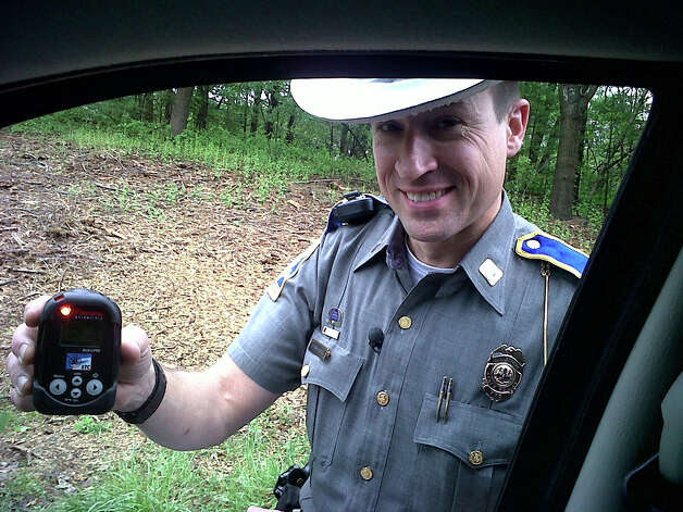 A Connecticut State Police trooper shows a radioactivity detector which is used to help identify potential terror threats. Mike Apatow of Milford was entering Interstate 84 in Newtown when he was pulled over by a trooper  who said Alpow flagged as a radioactive car. Thankfully, ApatowâÄôs doctor had given him a piece of paper documenting that heâÄôd had a medical procedure involving a small amount of radioactive material. Photo: Contributed Photo / Connecticut Post Contributed