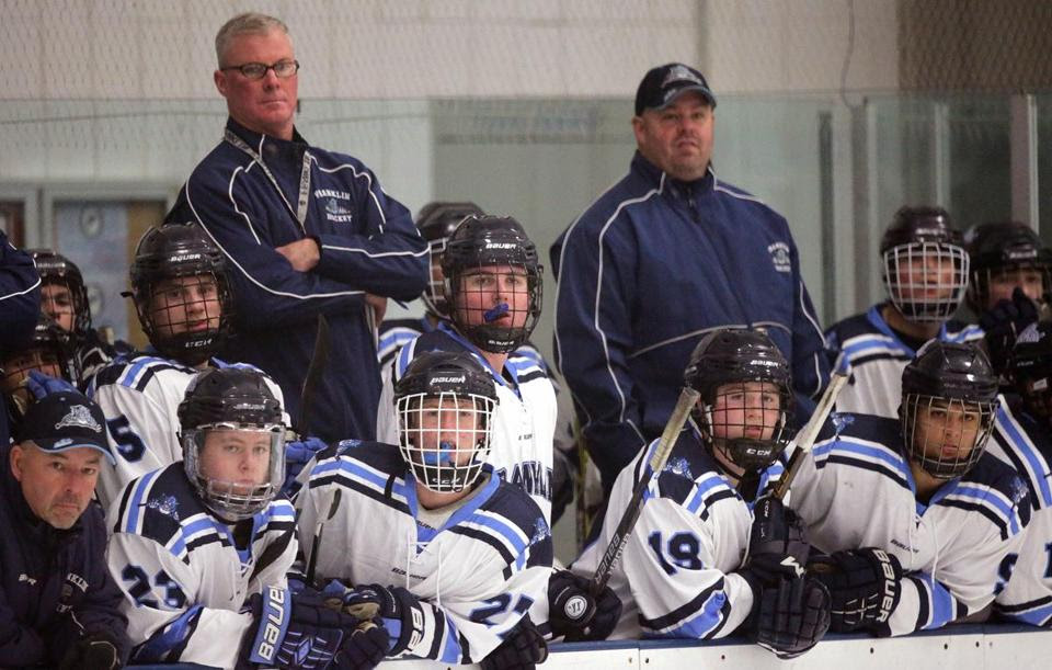Franklin head coach Chris Spillane (standing at left), watches a recent scrimmage against Medfield. (PHOTOS BY BARRY CHIN/GLOBE STAFF)