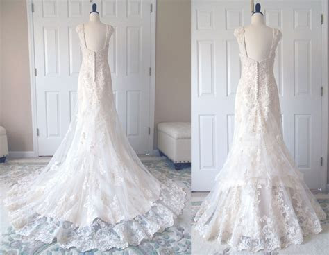 A traditional 4 point bustle in the lace overlay. A french