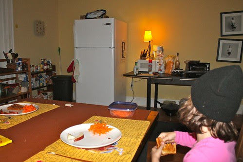 Our dining room made temporary kitchen/pantry...all the banging has done a number on those pics hanging huh?
