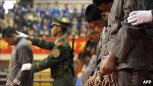 Chinese police show of a group of hardcore convicts at a sentencing rally in the east Chinese city of Wenzhou 07 April 2004