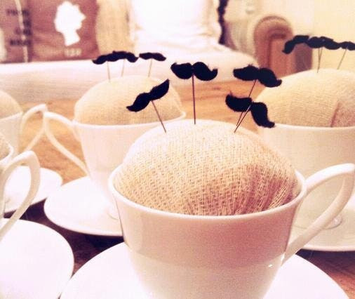 tea cup pincushion with mustache pins