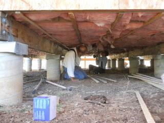 House Floor Installing Insulation Runners