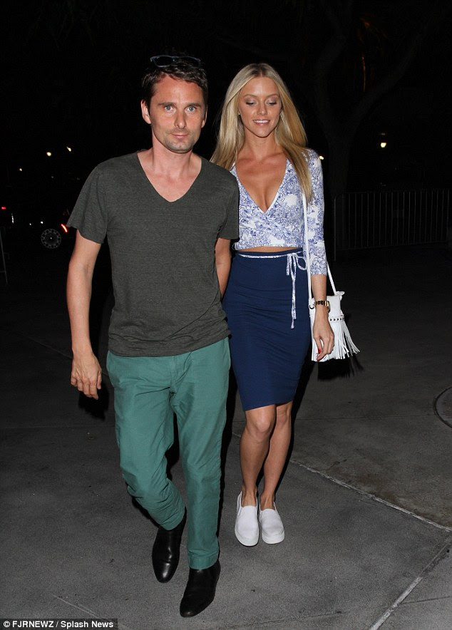 Going well: Things appear to be moving on pretty SWIFT-ly between Muse frontman Matt Bellamy and his model girlfriend Elle Evans as they attended a Taylor Swift gig on Tuesday evening at the Staples Center in LA