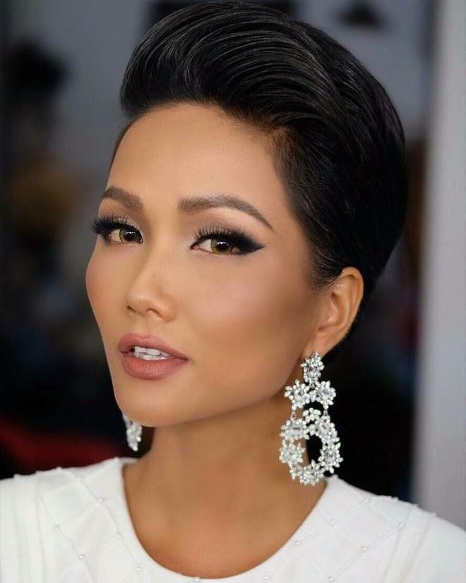 Hoa hậu HHen Niê ơi, cứ tóc ngắn thôi đừng để tóc dài và trang điểm đậm như này nhé! - Ảnh 1.