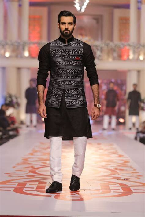 Make a dapper move in a black jacket like this.   Kurta