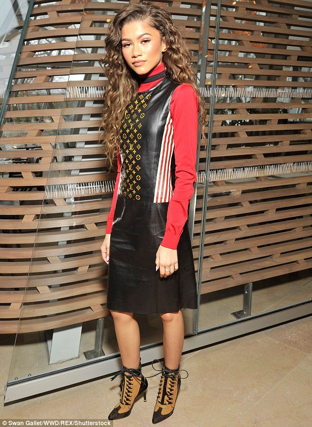 Going Hell for leather! Zendaya showcasing her sartorial sass in an edgy leather dress on the FROW at Louis Vuitton's Paris Fashion Week show, on Wednesday