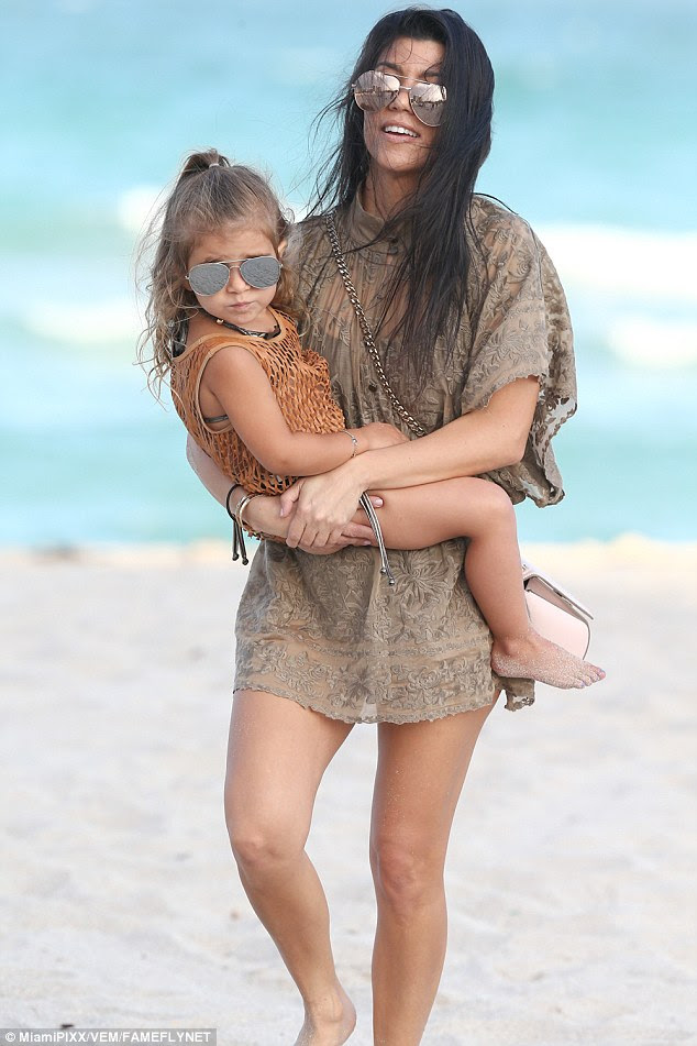 Too cool for school:Little Penelope certainly set the bar high, with the three-year-old rocking a metallic gold two piece with a gold mesh top