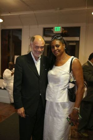Michael Lange and a friend pose at the reception leading into Black Media Appreciation Night on Sept. 13, 2014. – Photo: Malaika Kambon
